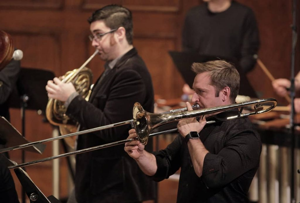 Michael Clayville playing trombone with Alarm Will Sound